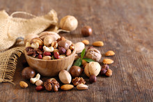 Organic Mix Nuts On A Wooden T...