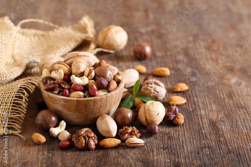 Fototapeta organic mix nuts on a wooden table obraz