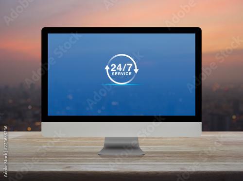 Vászonkép  24 hours service flat icon on desktop modern computer monitor screen on wooden t