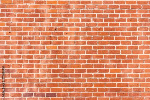 Photo sur Toile Brick wall A wall of rustic masonry bricks on a building
