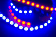 canvas print picture - Red blue neon garlands of bokeh lights and reflections. Festive background of 80s colors