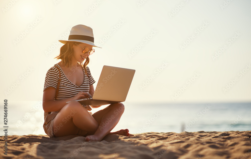 Fototapety, obrazy: young woman working with laptop on nature in beach
