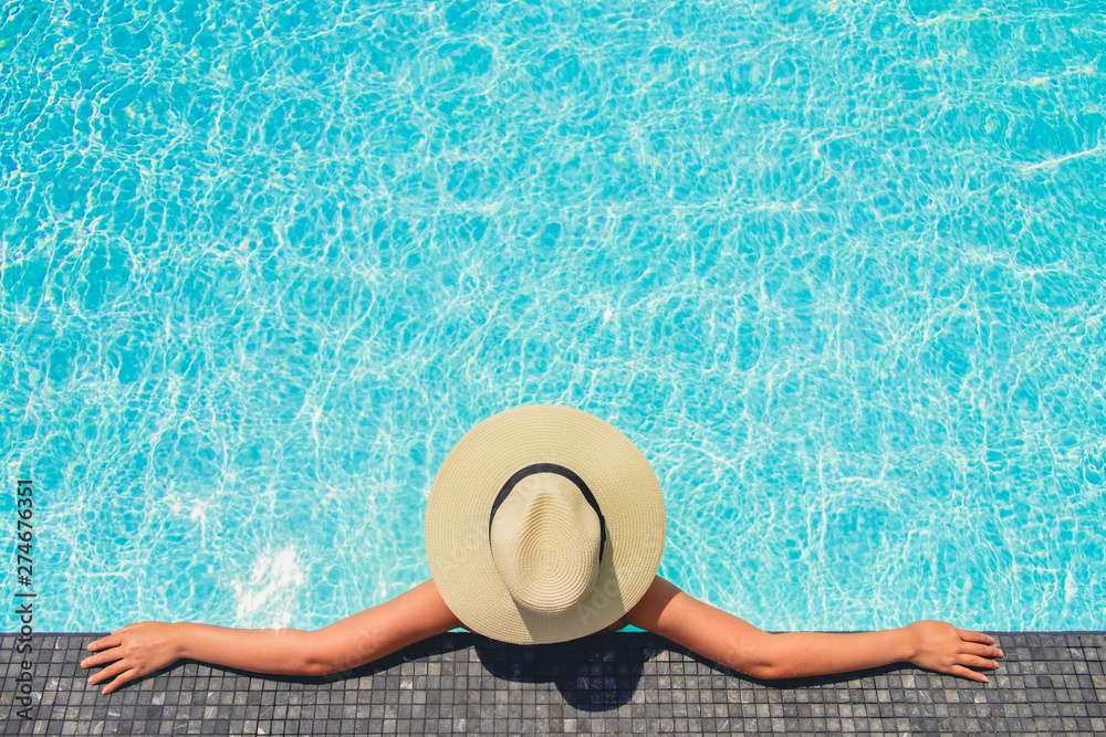 Fototapety, obrazy: Carefree woman relaxation in swimming pool summer Holiday concept