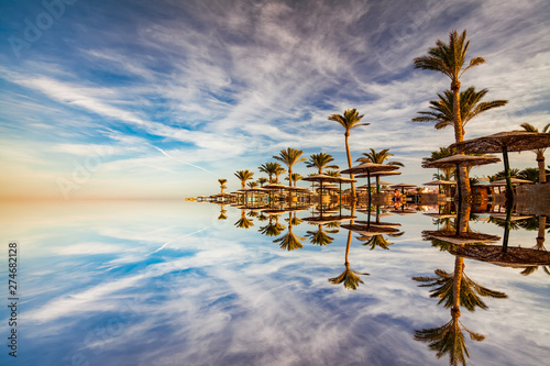beautiful-romantic-sunset-over-a-sandy-beach-and-palm-trees-egypt-hurghada