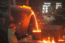 Work In The Foundry. Molten Metal Worker At A Metallurgical Plant