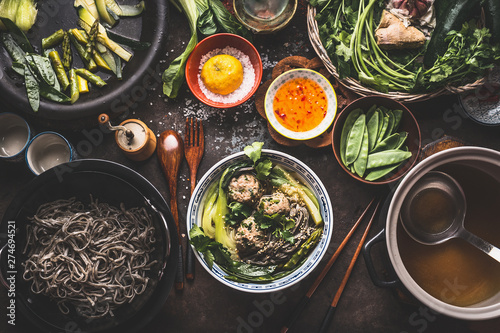 Photo  Asian food,Tasty ,noodle soup ,vegetables ,meat ,balls ,bowl, topped ,sesame, se