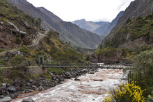 Bridge Across The Urubamba River At The Start Point Of The Inca Trail To Machu Picchu. Cusco, Peru
