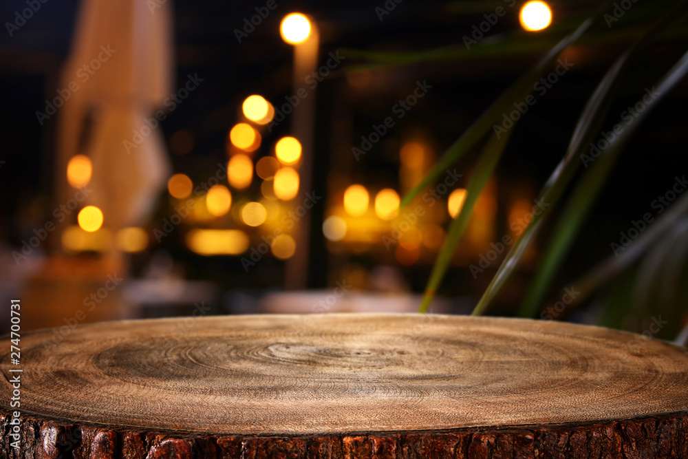Fototapety, obrazy: background of wooden table in front of abstract blurred restaurant lights