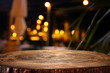 canvas print picture - background of wooden table in front of abstract blurred restaurant lights