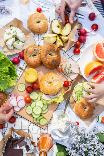 Poster Amsterdam Summer family picnic with bagels, vegetables and fruits.Top view. Healthy lifestyle