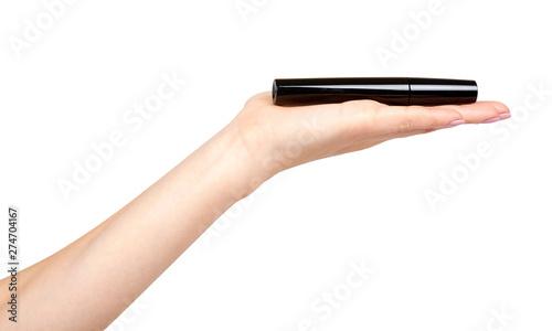 Fotografía  Hand with black mascara, eye makeup brush.