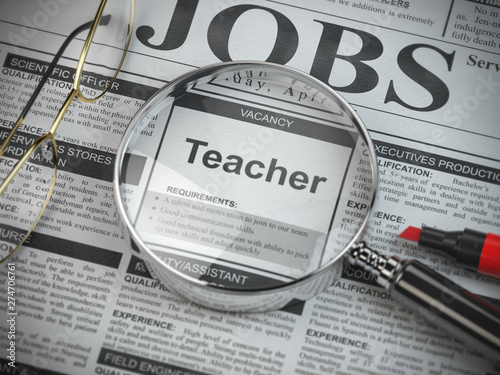 Valokuva  Teacher vacancy in the ad of job search newspaper with loupe.