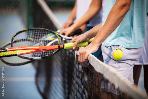 Fit happy poeple playing tennis together. Sport concept - 274712116