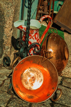 Copper Pans And Wrought Iron Objects