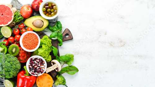 Spoed Fotobehang Eten Healthy Organic Food. Fresh fruits and vegetables. Top view. Free space for your text.