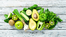 Fresh Organic Green Fruits And Vegetables. Avocado, Kiwi, Onion, Lime, Parsley. Organic Food. Rustic Style. Top View. Free Space For Text.