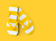 Top View Of Summer Beach Yellow Striped Flip Flop Isolated On Yellow Background Sea Holiday Vacation And Travel Concept