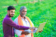 Leinwanddruck Bild - indian agronomist with farmer at field