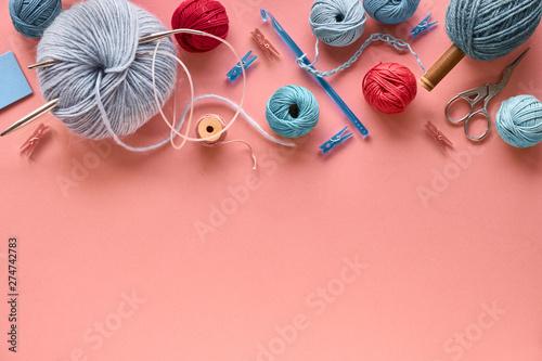 Various wool yarn and knitting needles, creative knitting hobby background Canvas Print
