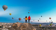 Couple In Love Among Balloons. Happy Couple In Cappadocia. Honeymoon In The Mountains. Man And Woman Traveling. Flying On Balloons. Festival Of Balloons