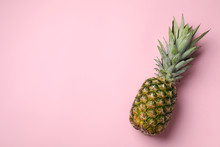 Fresh Whole Pineapple On Pink Background, Top View. Space For Text
