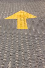 Yellow Arrow On Interlocking Pavement Pattern