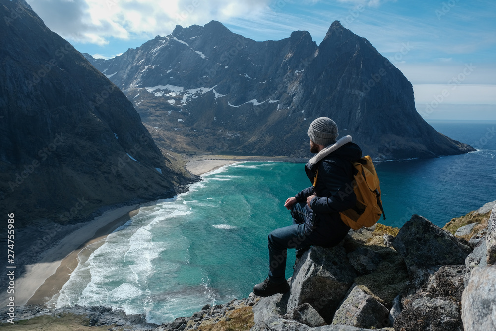 Fototapety, obrazy: Man sitting on cliff edge alone enjoying aerial view backpacking lifestyle travel adventure outdoor vacations in Norway top of Reinebringen mountain.