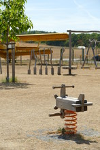 Wooden Children Swing In A Playground At The Airport
