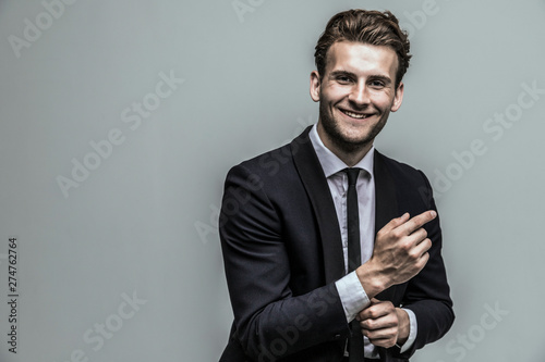 Carta da parati  Portrait of a smiling handsome model in a classic black and white style clothing
