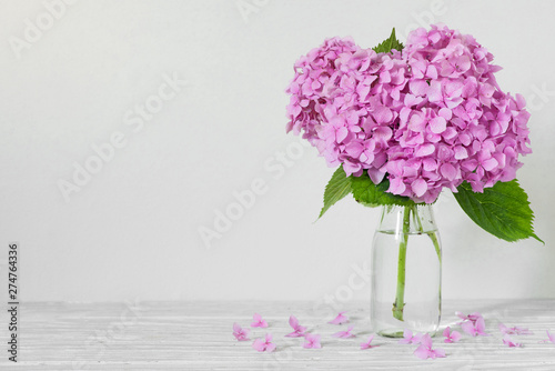 Still life with a beautiful pink hydrangea flowers on white wooden table with copy space. wedding background