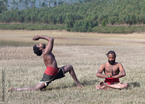 Indian Man Doing Yoga Exercise On Green Grass In Kerala South India Buy This Stock Photo And Explore Similar Images At Adobe Stock Adobe Stock