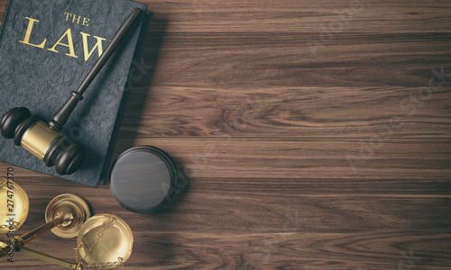 Fotografia, Obraz  Low key filter wooden judge's gavel on law book and golden scale on wood backgro