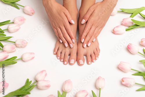 Female hands and feet with perfect done pedicure.