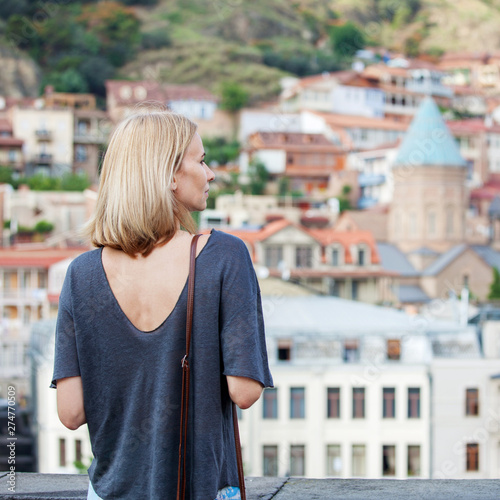 Kiev Woman tourist looking at the panorama of Tbilisi