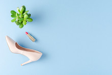 Fashion Background With High Heels And Lipstick. Top View