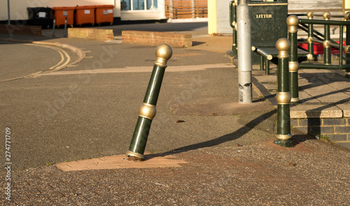 Valokuva  Phallic shaped metal bollard leaning over