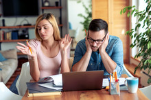 Couple With Laptop Paying Bills