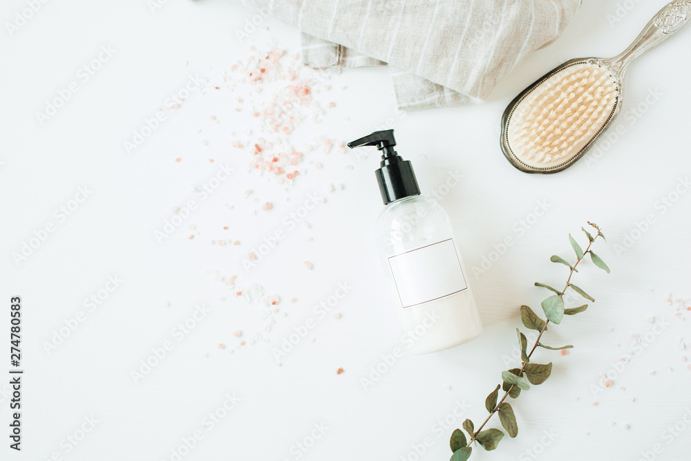 Fototapety, obrazy: Healthcare spa concept with copy space liquid soap bottle, eucalyptus, hairbrush on white background. Flat lay, top view beauty lifestyle composition.