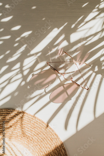 Fashion composition with women's accessories on white background. Sunglasses, straw hat on white background. Flat lay, top view trendy french style lifestyle blog concept. Wall mural