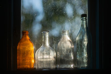 Four Old Fashioned Glass Bottl...