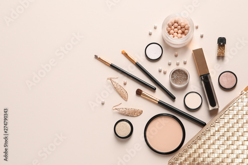 Cosmetic bag and different luxury makeup products on color background, flat lay Wallpaper Mural