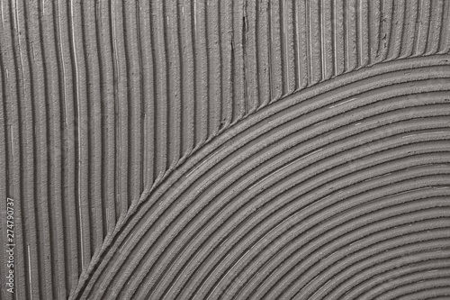 Lined grey concrete as background, top view. Tile installation Wallpaper Mural