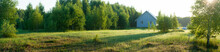 Ecologically Clean Corner Of Nature. Summer Rising Sun And Wooden House On A Farm. High Resolution Panorama, Can Be Used For Banner Or Background, Also Possible To Crop The Desired Part