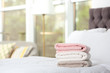 canvas print picture Stack of soft clean terry towels on bed. Space for text
