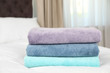 canvas print picture Stack of folded clean soft towels on bed