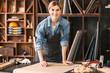 Portrait of female carpenter in workshop