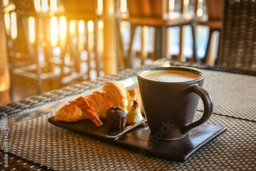 Coffee latte with croissant