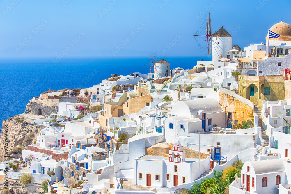 Fototapety, obrazy: Travel Destinations. Picturesque Cityscape of Oia Village in Santorini Island Located on Volcanic Calderra at Daytime. Traditional Windmills on Background.