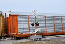 Train At A Railroad Crossing