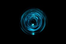 Abstract Glowing Blue Vortex With Light Ring On Black Background